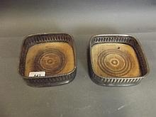 A pair of early C20th silver plated coasters, 5½