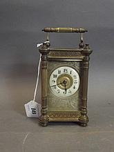 A C19th ornate brass carriage clock, 6