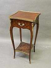 A C19th French rosewood bombe shaped stand with a