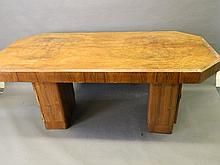 An Art Deco shaped walnut twin pedestal dining