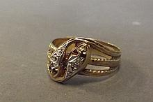 A 9ct gold ruby and diamond dress ring in the form