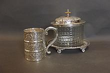 A silver plate and glass oval biscuit barrel on