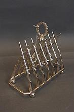 A silver plated toast rack in the form of crossed