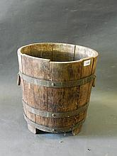 An early C20th brass bound oak coal bucket, bears