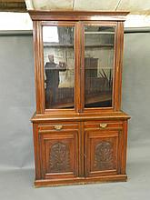 A late Victorian carved walnut library bookcase
