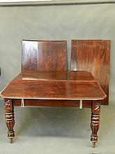 A Victorian mahogany extending dining table with