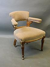 A Victorian walnut framed desk chair on turned