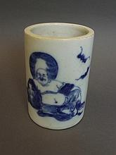 A Chinese blue and white brushpot with seated
