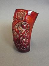 A Chinese horn cup with carved decoration of a