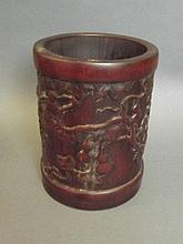 A Chinese bamboo brush pot with carved fruiting