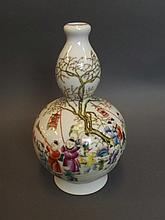 A Chinese porcelain double gourd vase with painted