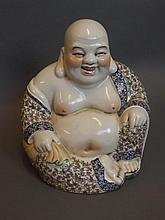 A Chinese pottery seated Buddha in painted floral