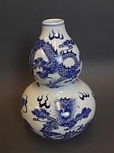 A Chinese blue and white double gourd vase with