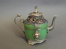 A Chinese metal and green glass teapot with