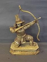A faux ivory figure of a kneeling samurai archer, 17½'' high