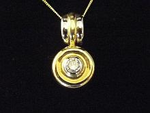 An 18ct gold solitaire diamond target shaped