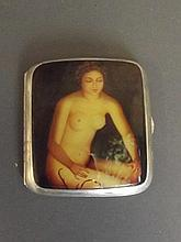 An unmarked silver cigarette case with later