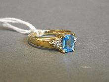 A 9ct gold square cut blue topaz and diamond ring,