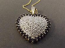 A 9ct gold pave diamond and sapphire heart shaped