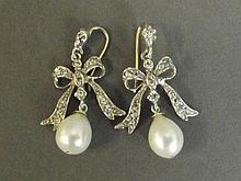 A pair of 9ct white gold and silver pearl drop