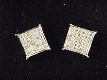 A pair of 9ct gold pave diamond set square stud