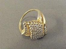 A 10ct gold diamond set twisted ring, size S