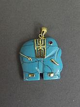 A turquoise and 18ct gold pendant carved in the