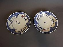 A pair of Japanese blue, white and red saucer