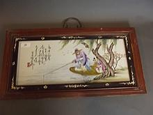 A Chinese wood framed pottery wall panel painted