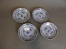 A set of 4 Chinese blue and white saucers painted