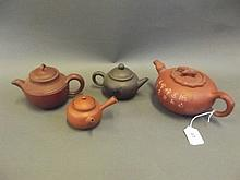A Chinese Yixing pottery teapot with engraved