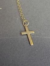 A 9ct gold cross on a chain, 17