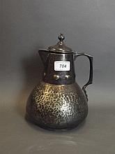A C19th Arts & Crafts silver plated hot water jug,