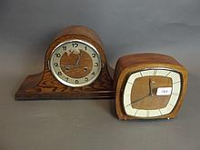 A 1930s oak cased mantle clock with a chiming