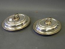 A pair of silver plated tureens and covers, 11