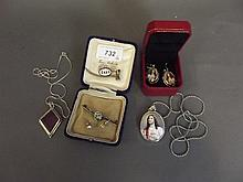 A silver and enamel pendant and earring set, a