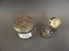 A Hallmarked silver topped glass jar and cover,