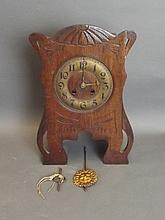A French oak and brass Art Nouveau mantle clock,