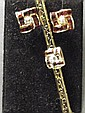 A 9ct gold garnet set and diamond brooch with