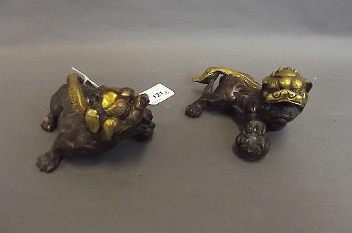 A pair of Chinese bronze and gilt bronze models of