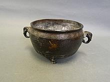A Chinese bronze twin handled censer on pawed feet