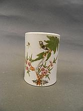 A Chinese pottery cylindrical vase painted with a