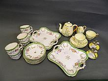 A C19th part service hand painted with flowers