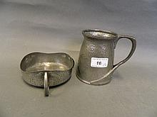 An Art Nouveau pewter tankard, 4½'' high, and an