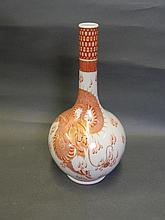 A Chinese bottle vase with painted red and gold