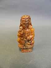 A Chinese hardstone pendant in the form of Quan