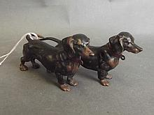 A cold painted bronze figure group of two Dachshun