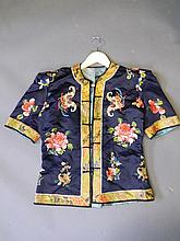 A small Chinese silk waistcoat with embroidered lo