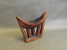 A late C19th African carved wood head rest, 7¼'' h