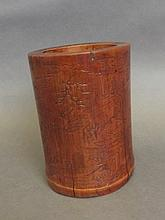 A Chinese bamboo brush pot carved with figures in